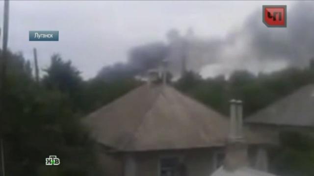Силовики разбомбили военокомат, диспансер и церковь в Луганске