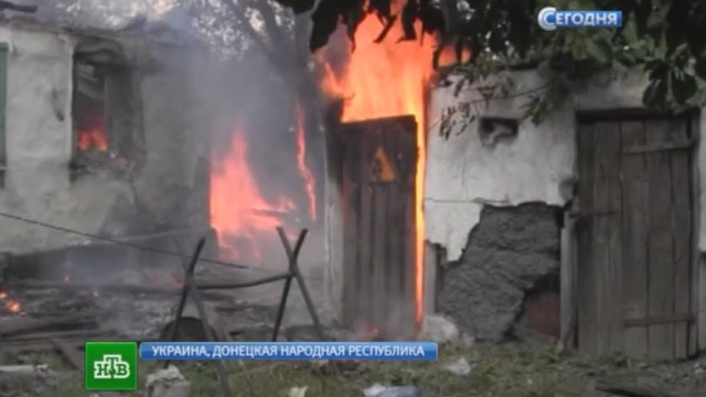 В Донецке и окрестностях снаряды силовиков разбомбили дома, церковь и больницу