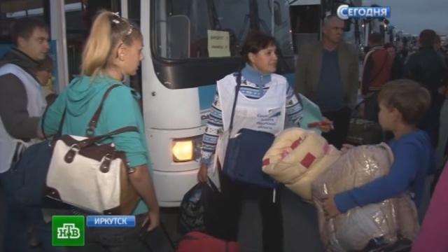 """""""Едем голые, босые и простоволосые"""": украинские беженцы прячутся от войны в Сибири"""