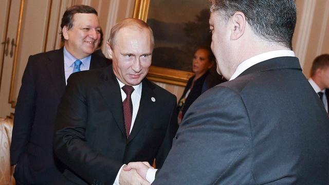 Путин и Порошенко беседуют за закрытыми дверями