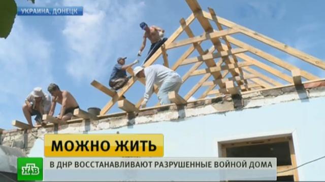 жители донецка поднимают руин разрушенные украинскими силовиками районы
