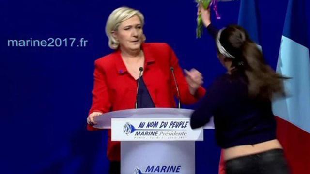 Женщина с букетом атаковала Марин Ле Пен в Париже: видео