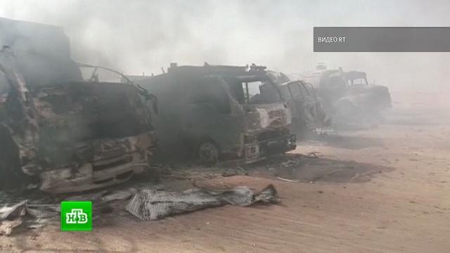 Дым и сгоревшие грузовики: появилось видео с места теракта в пригороде Дейр-эз-Зора