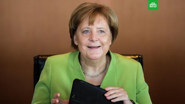 Меркель поздравила Медведева с назначением на пост премьер-министра