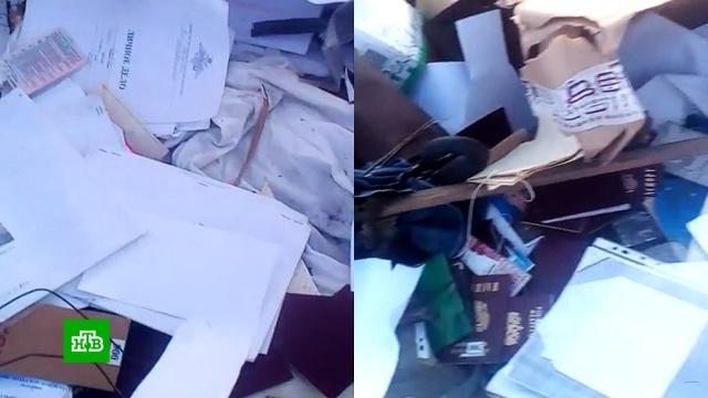 Жители Приморья нашли на свалке кипы паспортов и военных билетов