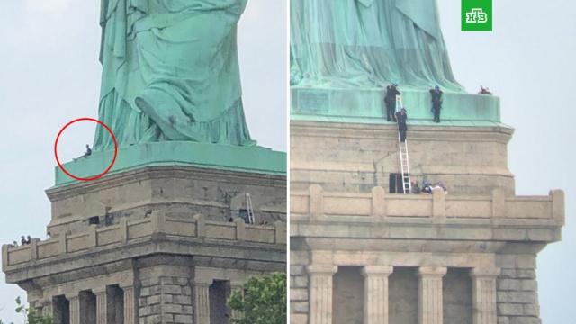 Полиция Нью-Йорка пытается снять со Статуи Свободы участницу акции протеста