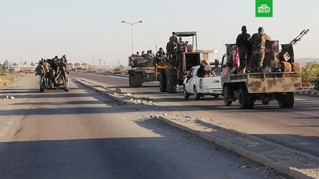 Боевики согласились сложить оружие в сирийской Дераа
